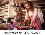 female sales assistant... | Shutterstock . vector #372396271