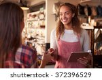 sales assistant with credit... | Shutterstock . vector #372396529