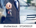 car keys hand showing keys of... | Shutterstock . vector #372450319