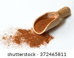 Stock photo ground cinnamon in wooden scoop on light background 372465811