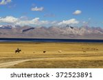 shepherd's life. song kul lake. ... | Shutterstock . vector #372523891