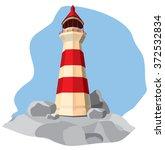 lighthouse on rock   Shutterstock .eps vector #372532834