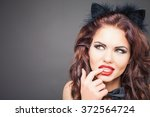 sexy woman with cat carnival... | Shutterstock . vector #372564724