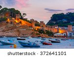 fortress and fishing boats at... | Shutterstock . vector #372641101