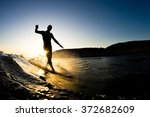 the silhouette of a surfer... | Shutterstock . vector #372682609
