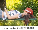 Teen Girl Laying On The Bench...