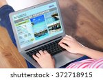 woman using laptop to book... | Shutterstock . vector #372718915