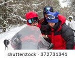 athletes go snowmobiling with... | Shutterstock . vector #372731341