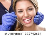 teeth checkup at dentist ... | Shutterstock . vector #372742684