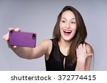 funny pretty woman in the black ... | Shutterstock . vector #372774415