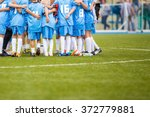 coach giving children's soccer... | Shutterstock . vector #372779881