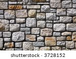 Close up background image of a modern stone wall. - stock photo