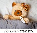 Sick Toy Bear In Bed With...