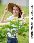 spring woman in green garden... | Shutterstock . vector #372858637