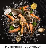 Fresh Seafood On Black Stone ...