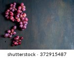 Red Grapes On Old Wood Table...