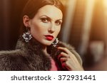 fashion portrait of a young... | Shutterstock . vector #372931441