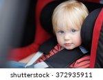 portrait of toddler boy sitting ... | Shutterstock . vector #372935911