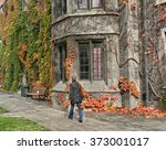 Stock photo college campus with ivy covered buildings in fall 373001017