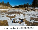 camp fire rock circle in snow | Shutterstock . vector #373003255
