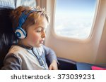 boy with headphones watching... | Shutterstock . vector #373039231