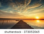 boat and wooden jetty on lake... | Shutterstock . vector #373052065