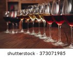 many glasses of different wine...   Shutterstock . vector #373071985