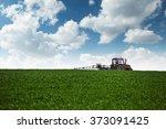 Farming Tractor Spraying Green...