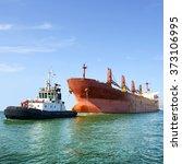 Tug Boat And Cargo Ship...