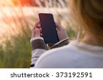 Woman Holding Smartphone Durin...