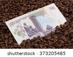 Small photo of Coffee beans and Kenya shilling banknote