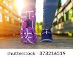 fitness girl running at sunset... | Shutterstock . vector #373216519