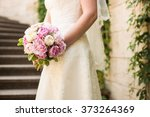 the bride holding a bouquet | Shutterstock . vector #373264369