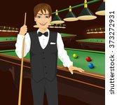 handsome man holding cue stick | Shutterstock .eps vector #373272931