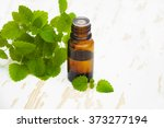 Bottle Of Essential Oil With...