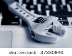 wrench on the laptop   Shutterstock . vector #37330840