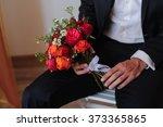 groom with bouquet   Shutterstock . vector #373365865