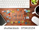 blog concept with workstation... | Shutterstock . vector #373413154