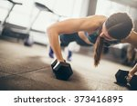 Woman Doing Push Up Exercise...