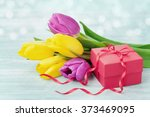 Gift Box And Tulip Flowers On...