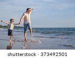 father and son playing on the... | Shutterstock . vector #373492501