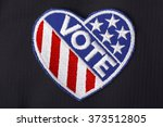 Closeup Of Usa Vote Badge On...