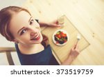 young healthy woman eats... | Shutterstock . vector #373519759