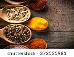 spices. spice in wooden spoon.... | Shutterstock . vector #373525981
