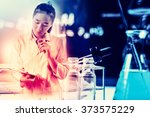 scientist writing report with... | Shutterstock . vector #373575229