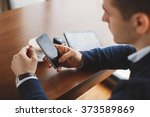 young hipster guy texting with... | Shutterstock . vector #373589869