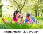 Family With Children Enjoying...