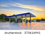 gas station at sunset. | Shutterstock . vector #373616941