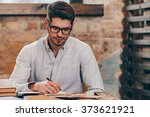 making some notes. handsome... | Shutterstock . vector #373621921