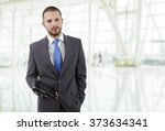 businessman with a tablet pc ... | Shutterstock . vector #373634341